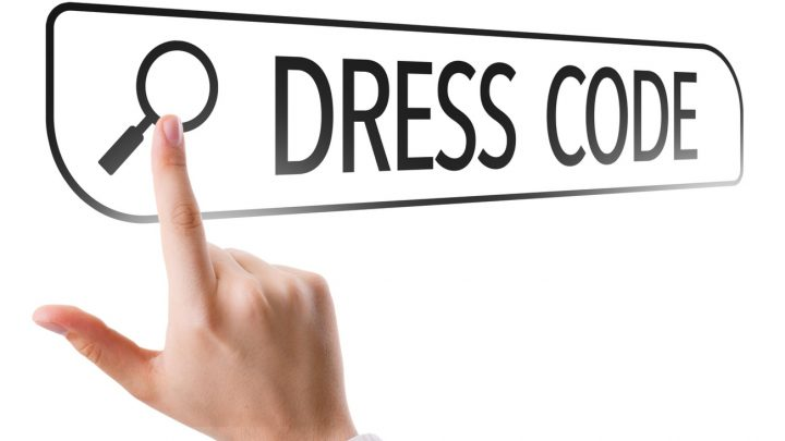 Person using their hand to search dress code
