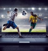 Football players shown through a laptop screen