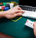 Person playing online and live poker with 2 ace cards