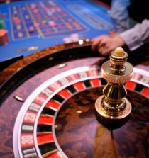 Roulette table with a dealer in the background