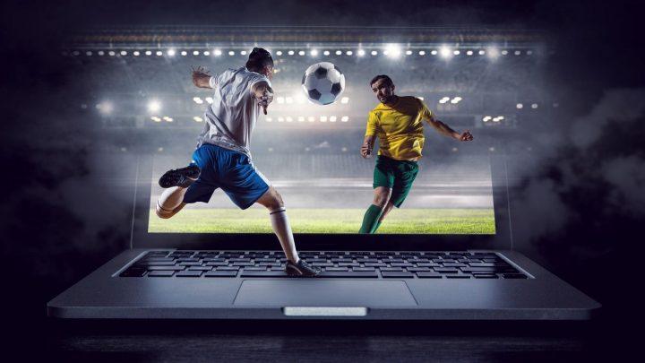 Football players shown through a laptop screen