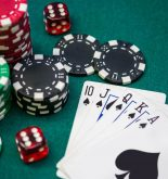 Poker chips, dice and poker cards on gambling table